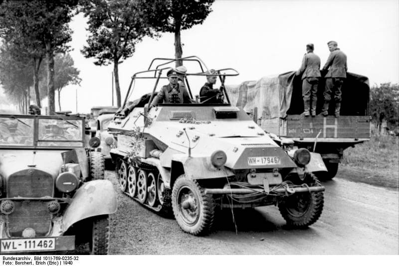Guderian in his radio Sd.Kfz 250 pass by transport on a French roadway